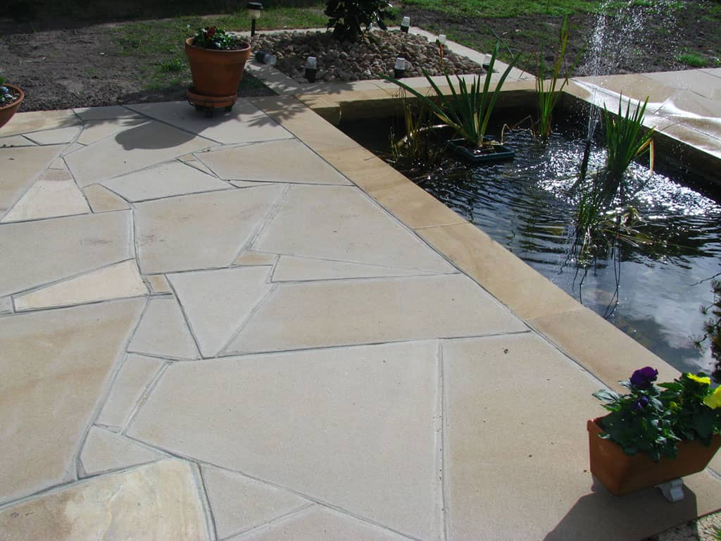 sandstone paving around pool area