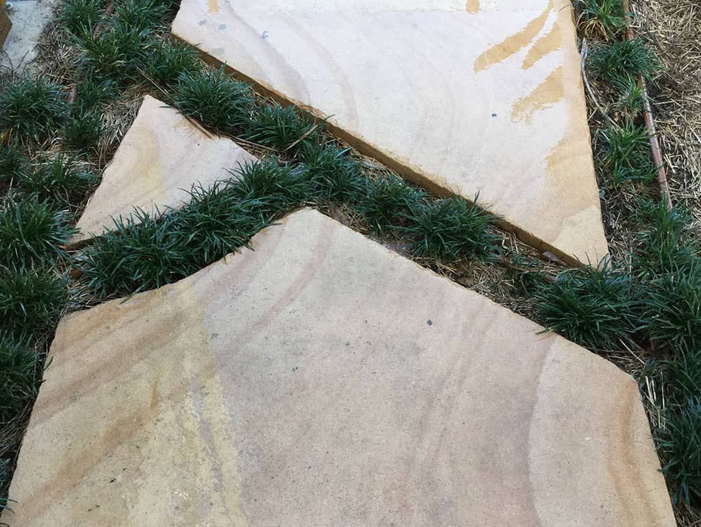 sandstone pavers within grass