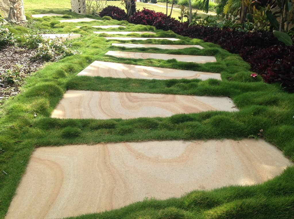 sandstone pavers surrounded by grass